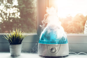The white humidifier moistens dry air. Improving the comfort of living in the home, apartment. Improving the well-being of people.