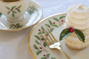 Close up of a cupcake and fork sitting on a Christmas plate