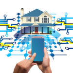 Hands holding a smart phone controlling an array of items in a home